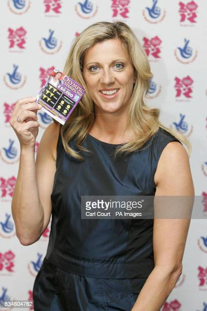 Olympic Gold Medalist Sally Gunnell holds an Olympic Champions scratchcard at the launch in Piccadilly London