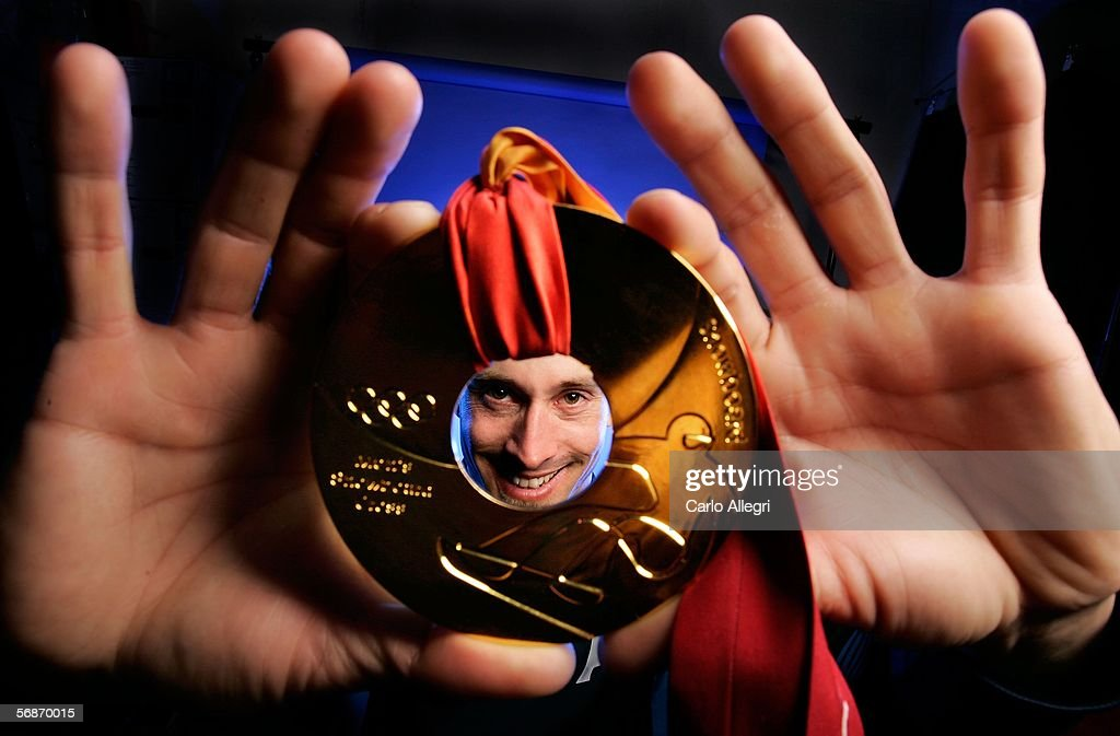 Olympic gold medalist Seth Wescott of the United States poses with his medal before appearing on NBC's Today Show during the Turin 2006 Winter...