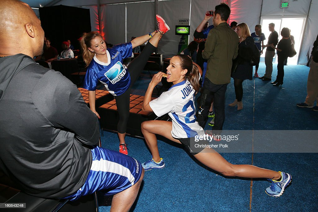 Olympic Gold Medalist Shawn Johnson (L) and bobsled athlete Lolo Jones attend DIRECTV'S Seventh Annual Celebrity Beach Bowl at DTV SuperFan Stadium at Mardi Gras World on February 2, 2013 in New Orleans, Louisiana.