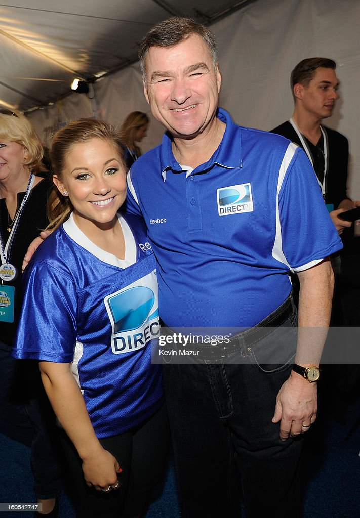 Olympic Gold Medalist Shawn Johnson and Chief Executive Officer and President of DIRECTV Michael White attends DIRECTV'S 7th annual celebrity Beach Bowl at DTV SuperFan Stadium at Mardi Gras World on February 2, 2013 in New Orleans, Louisiana.