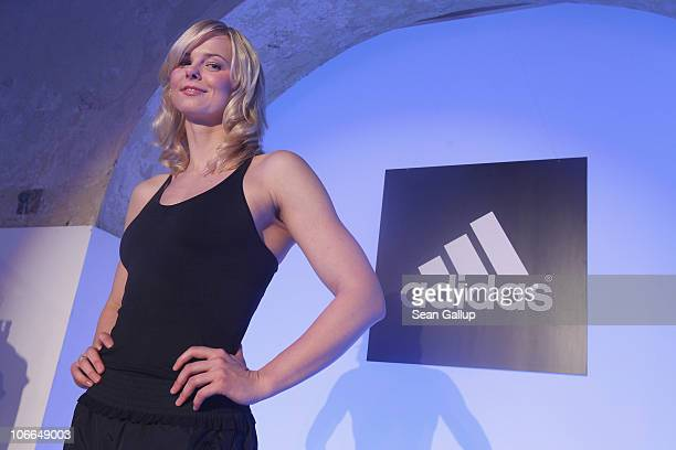 Olympic gold medalist swimmer Britta Steffen poses while wearing the adidas Women's TechFit allinone suit at the adidas Women's TechFit Launch...