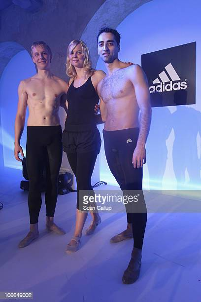 Olympic gold medalist swimmer Britta Steffen poses with members of the Staatsballett Berlin while wearing the adidas Women's TechFit allinone suit at...
