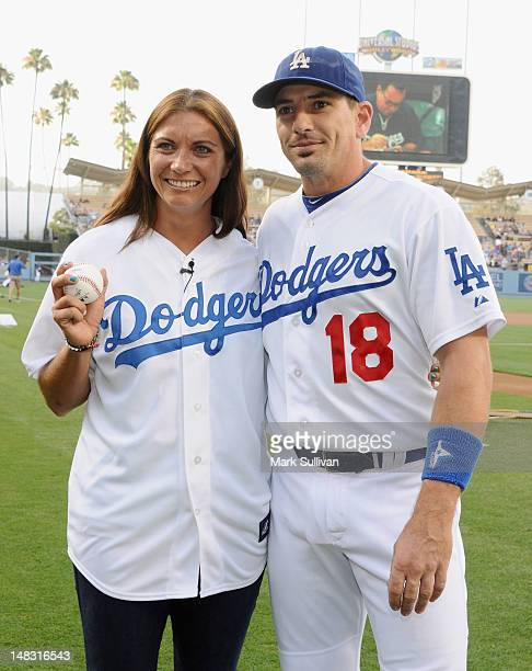 Olympic Gold Medalist/professional beach volleyball player Misty MayTreanor and husband Los Angeles Dodger catcher Matt Treanor pose before throwing...