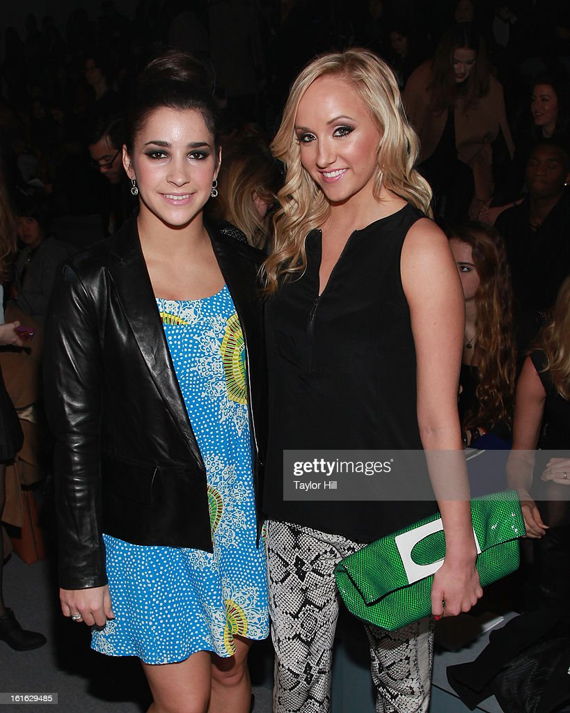 Olympic gold medalists in gymnastics Alexandra Raisman and Nastia Liukin attend the Nanette Lepore Fall 2013 Mercedes-Benz Fashion Show at The Stage at Lincoln Center on February 13, 2013 in New York City.