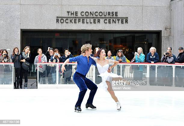 Olympic Gold Medalists Meryl Davis and Charlie White perform first skate of the season at The Rink at Rockefeller Center on October 13 2014 in New...