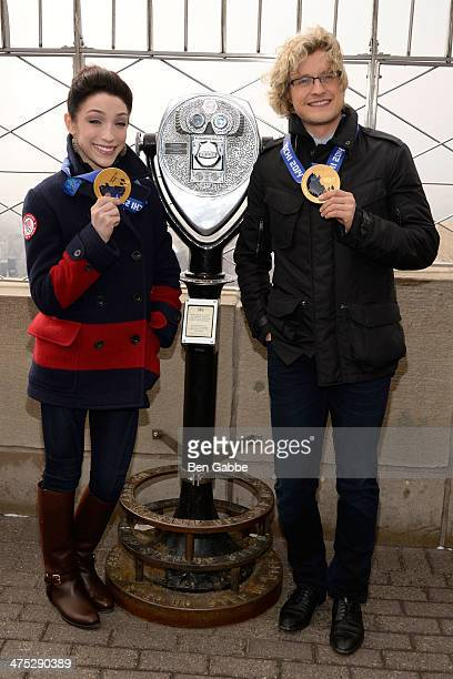Olympic Gold Medalists Meryl Davis and Charlie White visit The Empire State Building on February 27 2014 in New York United States