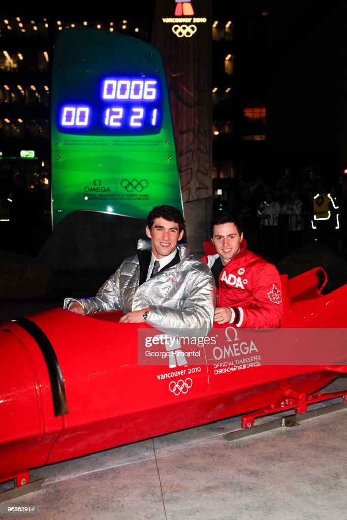 Olympic Gold Medalists <a gi-track='captionPersonalityLinkClicked' href=/galleries/search?phrase=Michael+Phelps&family=editorial&specificpeople=162698 ng-click='$event.stopPropagation()'>Michael Phelps</a> (L) and <a gi-track='captionPersonalityLinkClicked' href=/galleries/search?phrase=Alexandre+Bilodeau&family=editorial&specificpeople=814666 ng-click='$event.stopPropagation()'>Alexandre Bilodeau</a> attend the OMEGA Cocktail Celebration at the Fairmont Hotel on February 18, 2010 in Vancouver, Canada.