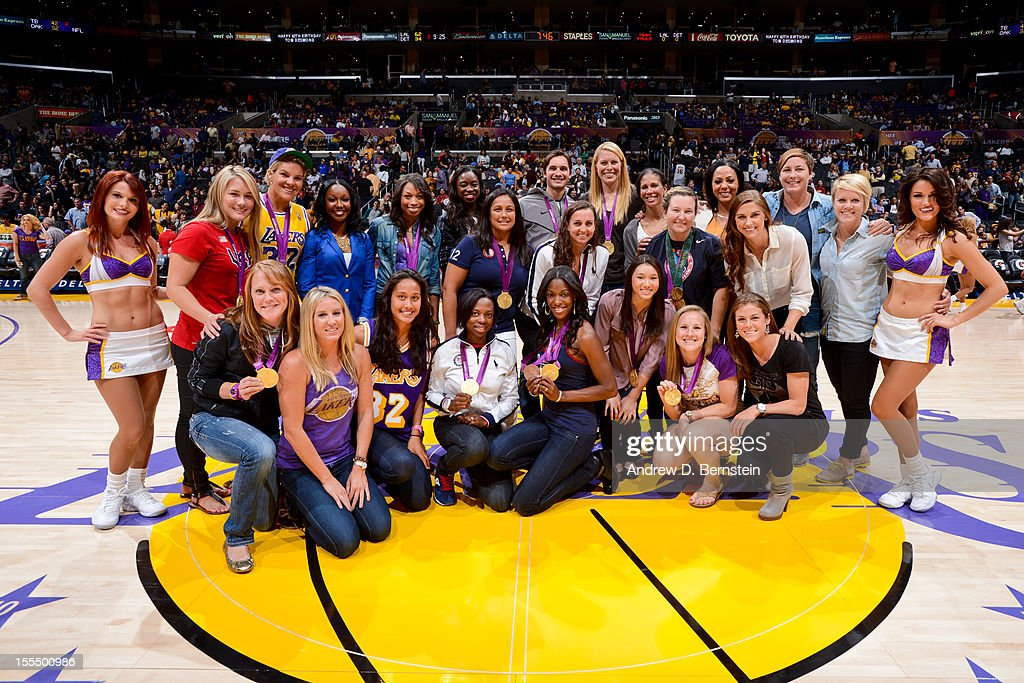 Olympic gold medalists who reside in Southern California pose for a photo at halftime of a game between the Detroit Pistons and Los Angeles Lakers at Staples Center on November 4, 2012 in Los Angeles, California.