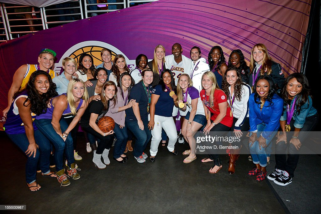 Olympic gold medalists who reside in Southern California pose for a photo with former Olympic gold medalist <a gi-track='captionPersonalityLinkClicked' href=/galleries/search?phrase=Kobe+Bryant&family=editorial&specificpeople=201466 ng-click='$event.stopPropagation()'>Kobe Bryant</a> #24 of the Los Angeles Lakers at halftime of a game against the Detroit Pistons at Staples Center on November 4, 2012 in Los Angeles, California.