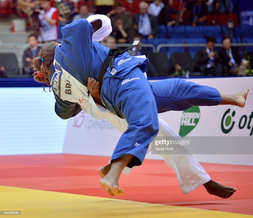 Olympic gold medallist, Idalys Ortiz of Cuba (white) throws Maria Suelen Altheman of Brazil for ippon (10 points) to win the o78kg gold medal during the Chelyabinsk Judo World Championships at the Sport Arena 'Traktor' on August 30, 2014 in Chelyabinsk, Russia.
