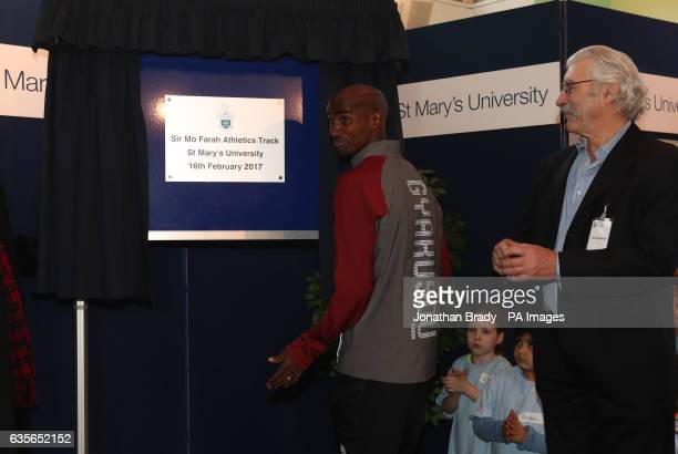 Olympic gold medallist Mo Farah unveils a plaque at an athletics track named in his honour at St Mary's University in Twickenham
