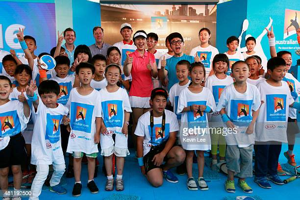 Olympic gold medallist Sun Tiantian poses with children at an Australian Open 2016 event July 19 2015 in Shanghai China