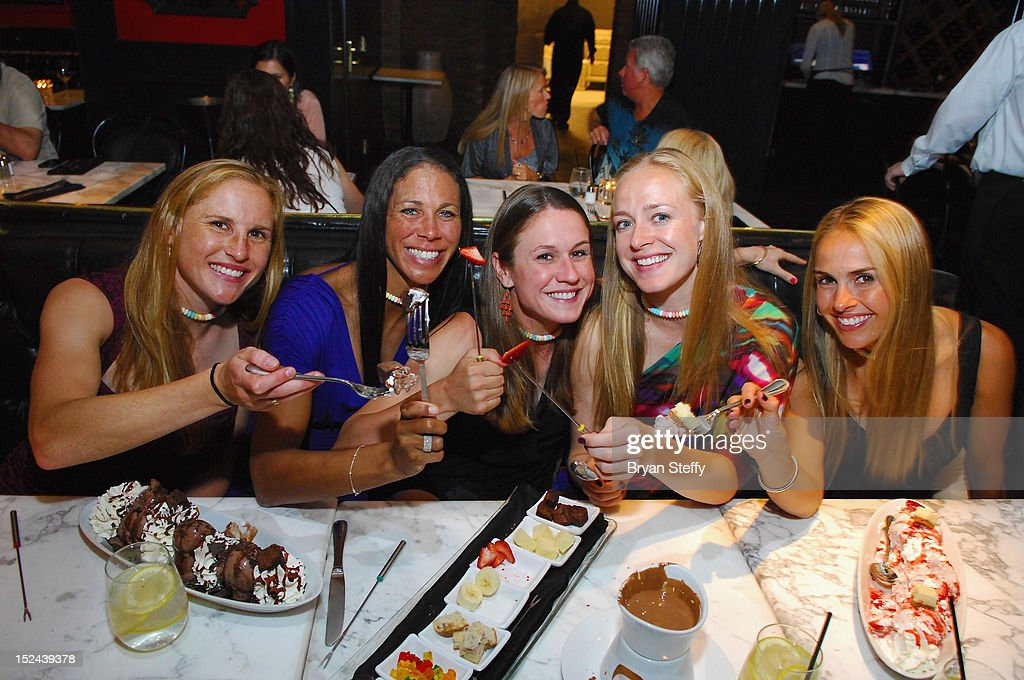 Olympic Gold Medal-Winning Women's Soccer Team Players, Rachel Buehler, Shannon Boxx, Heather O'Reilly, Becky Sauerbrunn and Heather Mitts, dine at the Sugar Factory American Brasserie at the Paris Las Vegas on September 20, 2012 in Las Vegas, Nevada.
