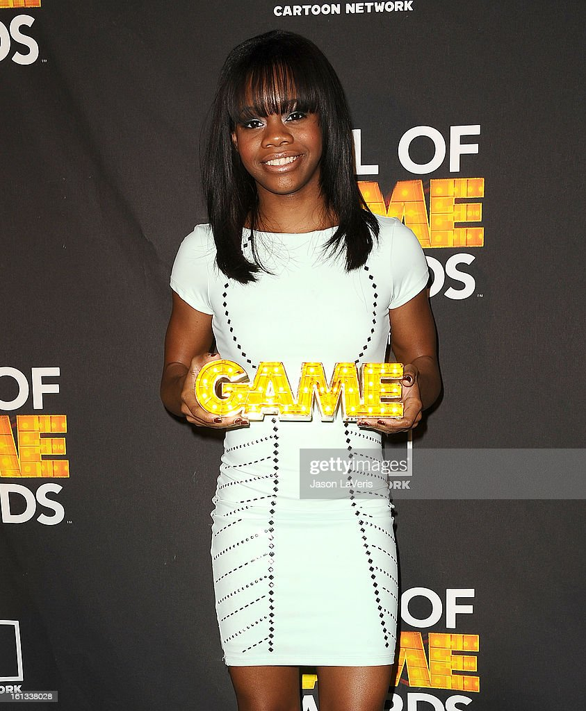 Olympic gymnast Gabby Douglas poses in the press room at Cartoon Network's 3rd annual Hall Of Game Awards at Barker Hangar on February 9, 2013 in Santa Monica, California.