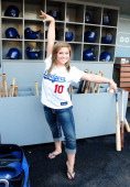Olympic gymnast Shawn Johnson Warms Up by Dancing before throwing the ceremonial first pitch at Dodgers game at Dodger Stadium on June 1 2009 in Los...