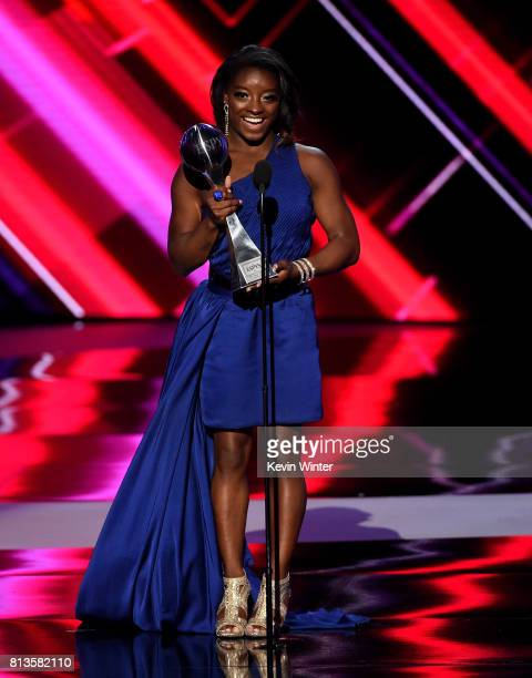 Olympic gymnast Simone Biles accepts the Best Female Athlete award onstage at The 2017 ESPYS at Microsoft Theater on July 12 2017 in Los Angeles...