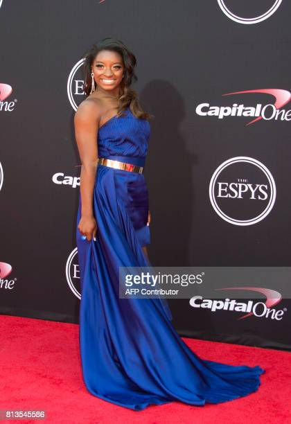 Olympic gymnast Simone Biles attends the 25th ESPYS at the Microsoft Theater on July 12 2017 in Los Angeles California / AFP PHOTO / VALERIE MACON