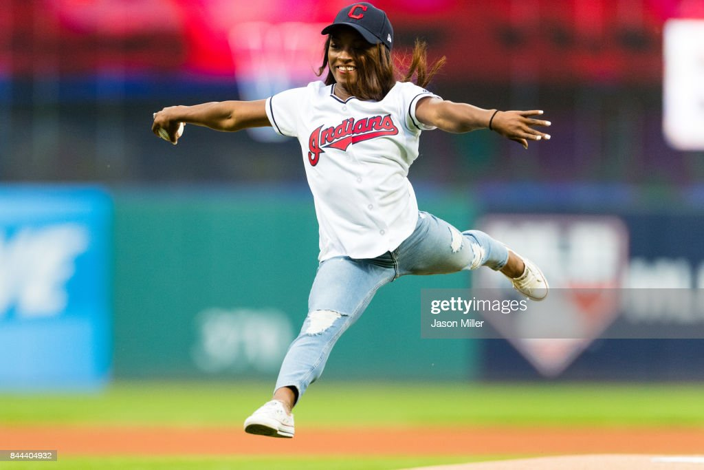 Olympic Gymnast Simone Biles throws out the first pitch prior to the game between the Cleveland Indians and the Baltimore Orioles at Progressive Field on September 8, 2017 in Cleveland, Ohio.