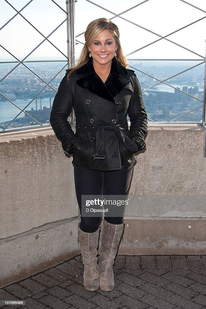 Olympic gymnastics gold medalist Shawn Johnson visits The Empire State Building on November 28, 2012 in New York City.