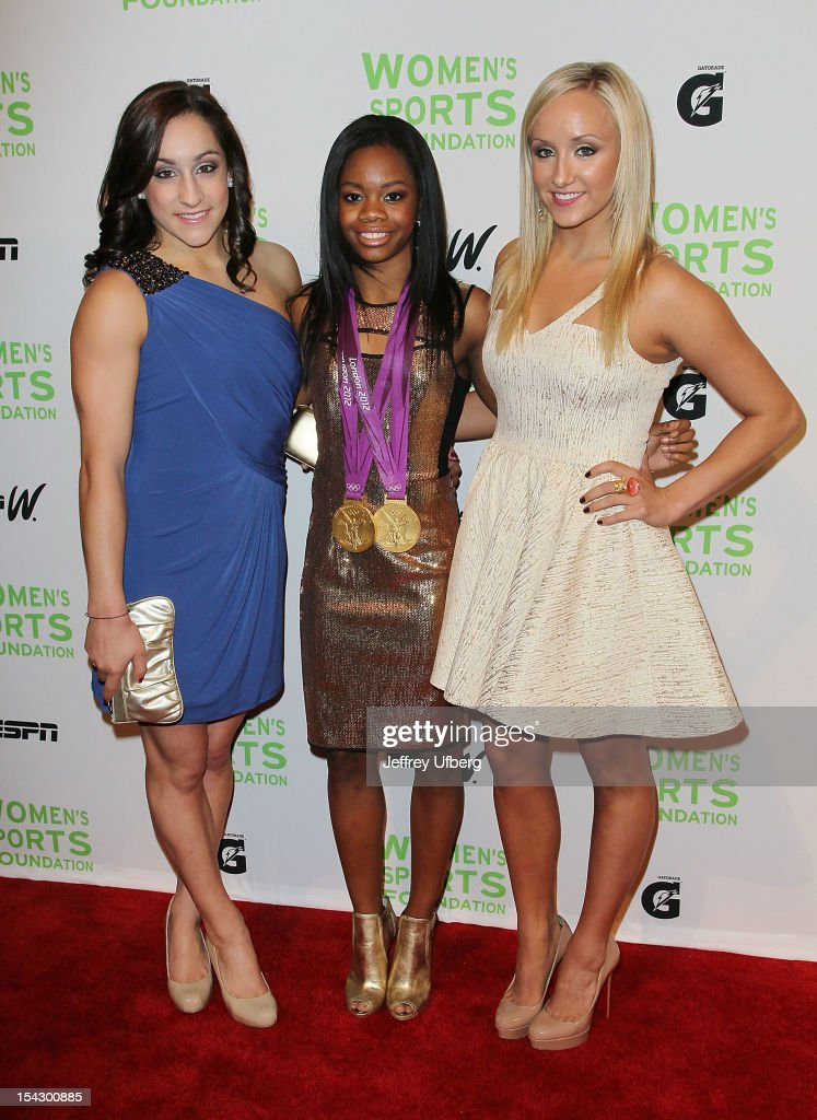 Olympic gymnasts <a gi-track='captionPersonalityLinkClicked' href=/galleries/search?phrase=Jordyn+Wieber&family=editorial&specificpeople=5720749 ng-click='$event.stopPropagation()'>Jordyn Wieber</a>, Gabrielle Douglas, and <a gi-track='captionPersonalityLinkClicked' href=/galleries/search?phrase=Nastia+Liukin&family=editorial&specificpeople=241334 ng-click='$event.stopPropagation()'>Nastia Liukin</a> attend the 33rd Annual Salute To Women In Sports Gala>> at Cipriani Wall Street on October 17, 2012 in New York City.