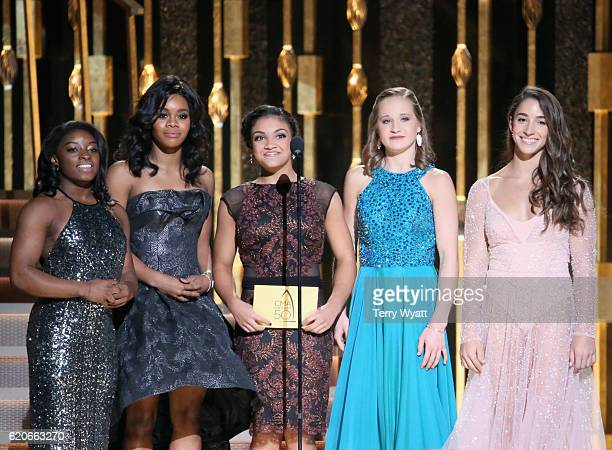 Olympic gymnasts Simone Biles Laurie Hernandez Gabby Douglas Madison Kocian and Aly Raisman presents an award onstage at the 50th annual CMA Awards...