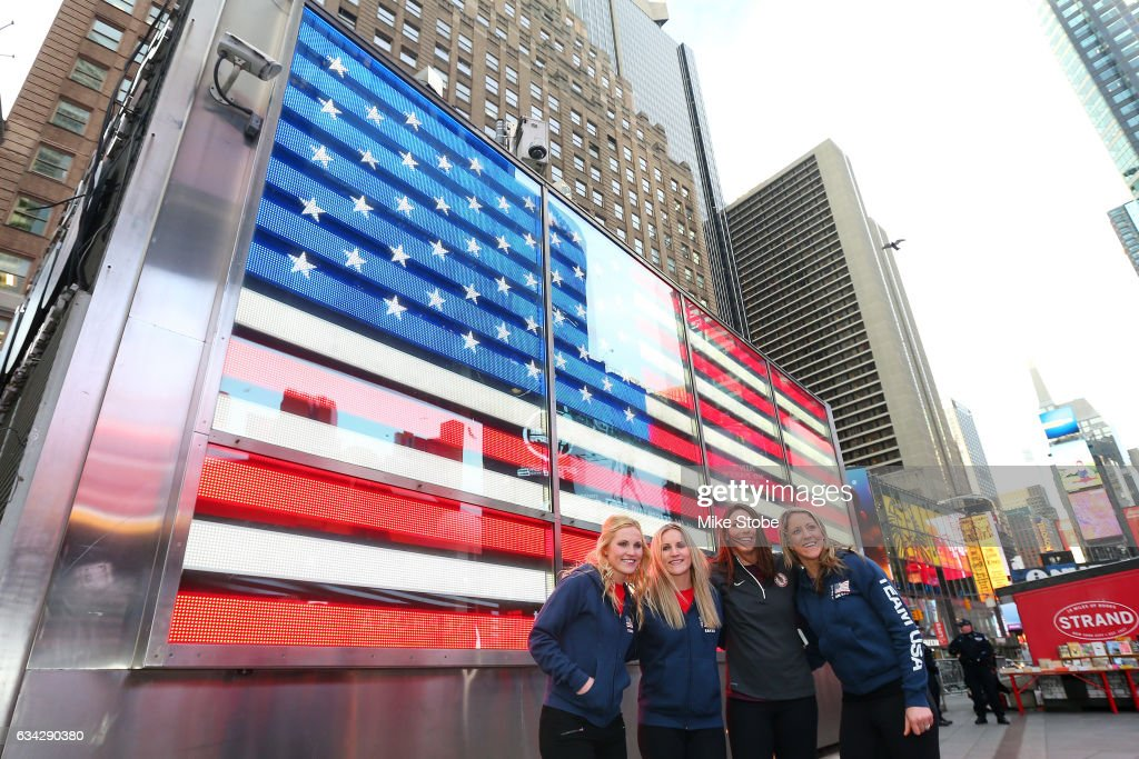 Olympic hopefulls Jocelyne Lamourex, Monique Lamoureux, Hilary Knight and Meghan Duggan pose for a photo outside the NASDAQ Stock Market on February 8, 2017 in New York City. Team USA celebrates the one-year countdown to the Olympic Winter Games PyeongChang 2018.