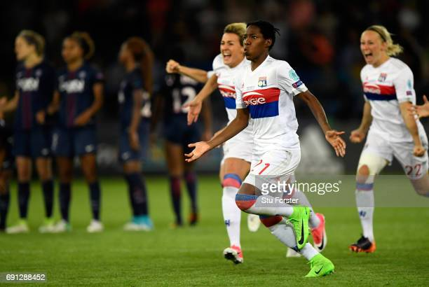 Olympic Lyon players race to celebrate with goalkeeper Sarah Bouhaddi who had scored the winning penalty during the UEFA Women's Champions League...