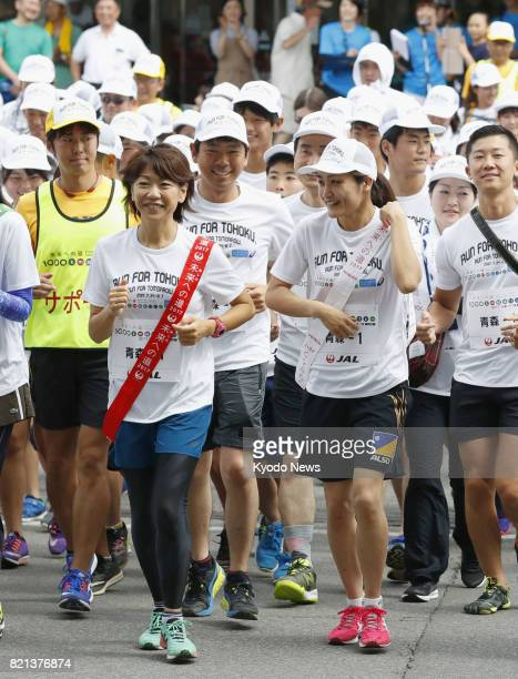Olympic marathon gold medalist Naoko Takahashi and Olympic wrestling champion Kaori Icho take part in the opening leg of a 1000kilometer citizens'...
