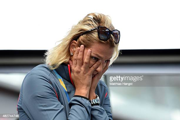 Olympic medallist Franziska van Almsick of Germany reacts to competition on day nine of the 16th FINA World Championships at the Kazan Arena on...