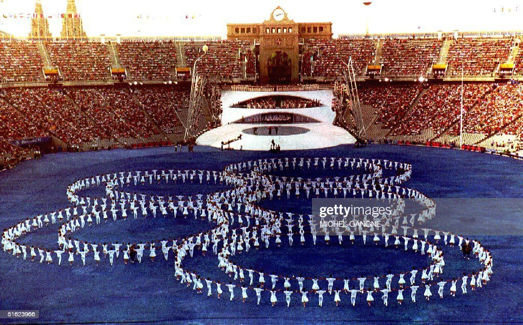 Olympic rings are formed by dancers against a blue ground during the rehearsal of the 1992 Summer Olympics opening ceremony at the Olympic Stadium 23...