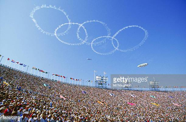 Olympic rings of smoke appear above the crowd at the opening ceremony of the 23rd Olympic Games held in Olympic Statium Los Angeles in 1984