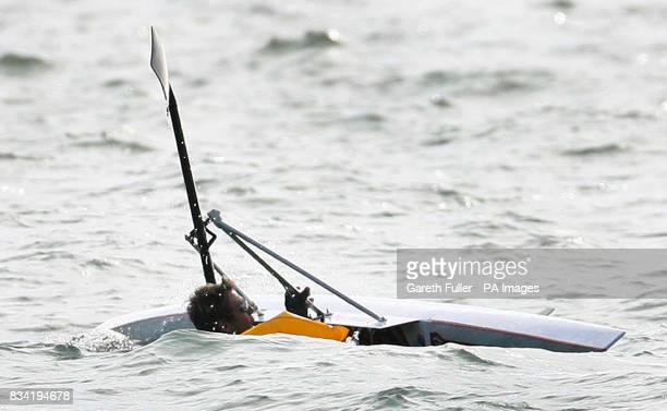 Olympic rower James Cracknell capsizes as he leaves Shakespeare Beach in Dover Kent on the first leg of his CrossContinent Challenge in aid of Sport...