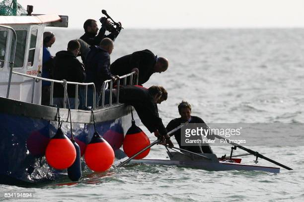 Olympic rower James Cracknell is helped back into his boat after capsizing in his first attempt to leave Shakespeare Beach in Dover Kent on the first...