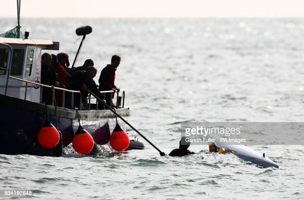 Olympic rower James Cracknell is helped from the water after capsizing in his first attempt to leave Shakespeare Beach in Dover Kent on the first leg...