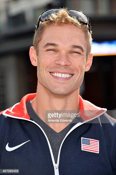 Olympic runner Nick Symmonds unveils PETA's new crueltyfree shopping campaign to holiday shoppers at 3rd Street Promenade on December 16 2013 in...