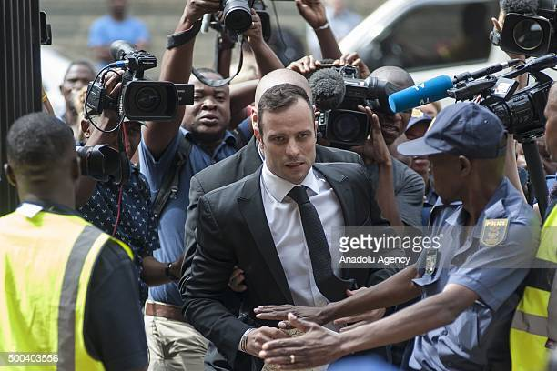Olympic runner Oscar Pistorius walks past the media members as he arrives to appear in Pretoria High court to apply for bail after Supreme Court...