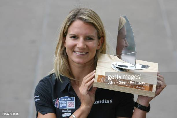 Olympic Sailing bronze medallist Bryony Shaw shows off a trophy presented to her by team sponsor Skandia at a homecoming for Team GB's Sailors at the...