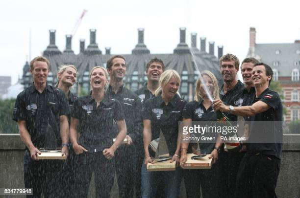 Olympic Sailing medallist Nick Rogers opens the champagne as fellow medallists Paul Goodison Sarah Webb Pippa Wilson Ben Ainslie Andrew Simpson Sarah...
