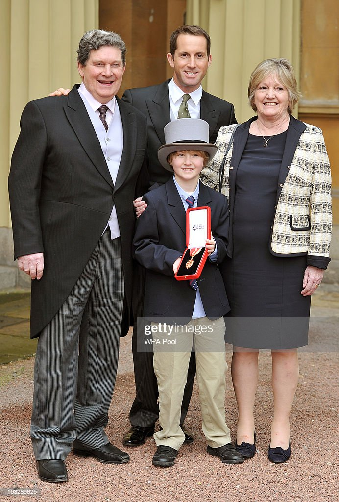 Olympic sailor Sir <a gi-track='captionPersonalityLinkClicked' href=/galleries/search?phrase=Ben+Ainslie&family=editorial&specificpeople=208865 ng-click='$event.stopPropagation()'>Ben Ainslie</a> poses with his parents Roddy and Sue, and his nephew Oscar Pels aged 8, after receiving his Knighthood at the Investiture Ceremony at Buckingham Palace on March 07, 2013 in London, England.