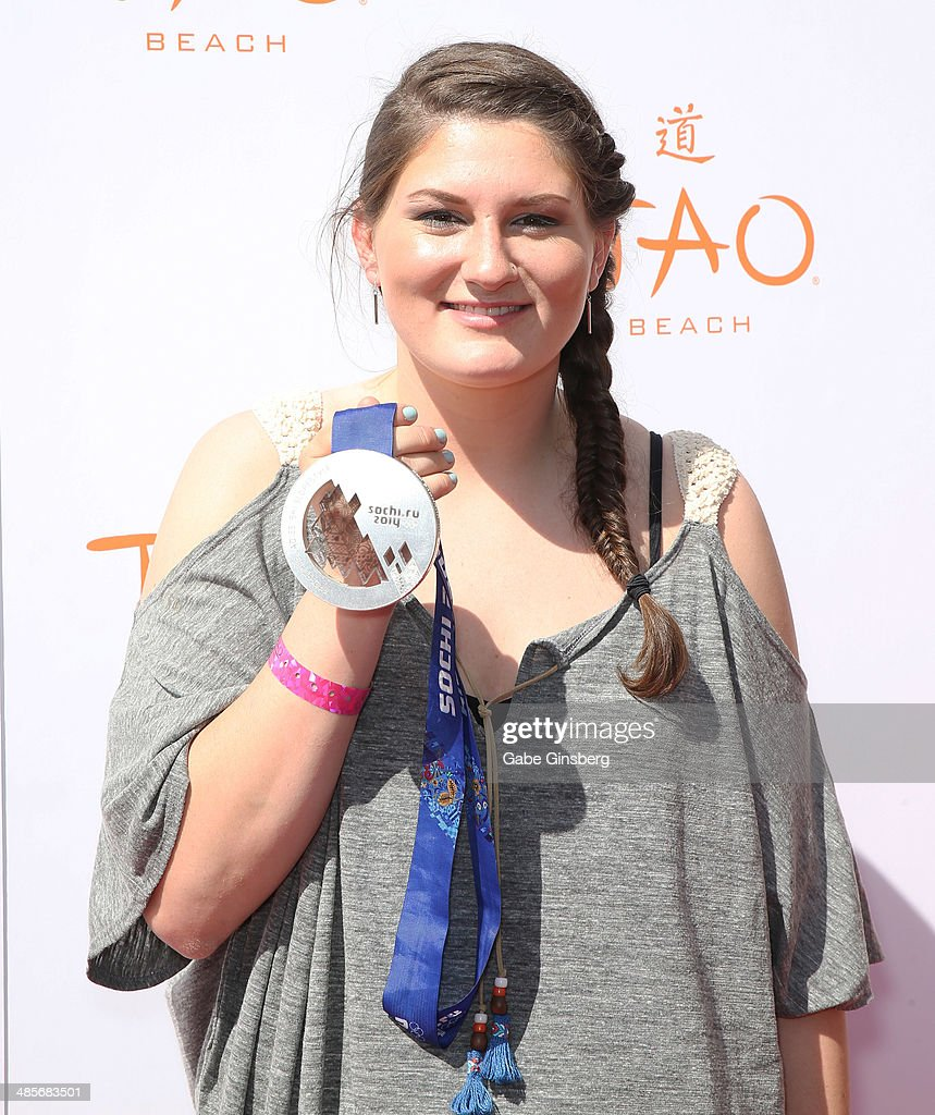 Olympic skier Devin Logan holds up her silver metal as she arrives at the grand opening of Tao Beach season at the Tao Beach at The Venetian Las Vegas on April 19, 2014 in Las Vegas, Nevada.