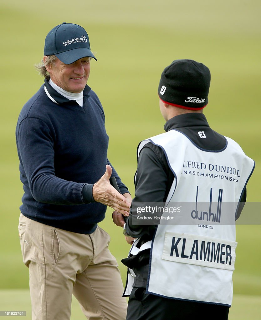 Olympic skier Franz Klammer with his caddy on the 18th green during the first round of the Alfred Dunhill Links Championship on The Old Course, at St Andrews on September 26, 2013 in St Andrews, Scotland.