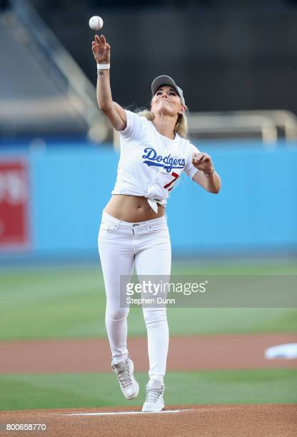 Olympic skier Lindsey Vonn throws out the ceremonial first pitch before the game between the Colorado Rockies and the Los Angeles Dodgers at Dodger...