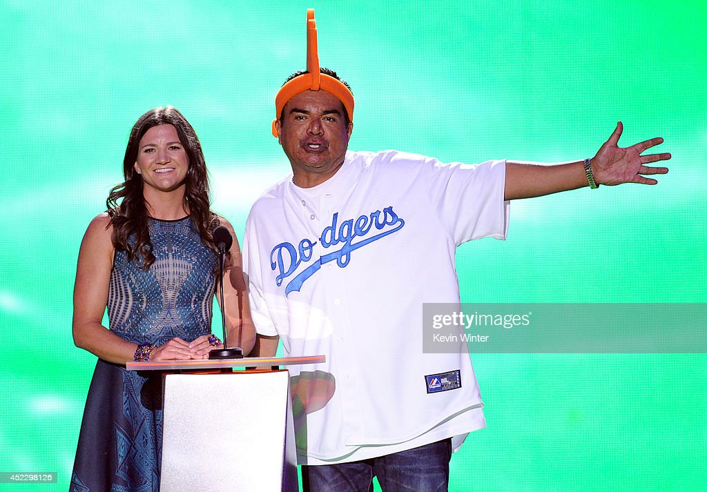 Olympic snowboarder Kelly Clark and TV personality George Lopez speak onstage during Nickelodeon Kids' Choice Sports Awards 2014 at UCLA's Pauley...