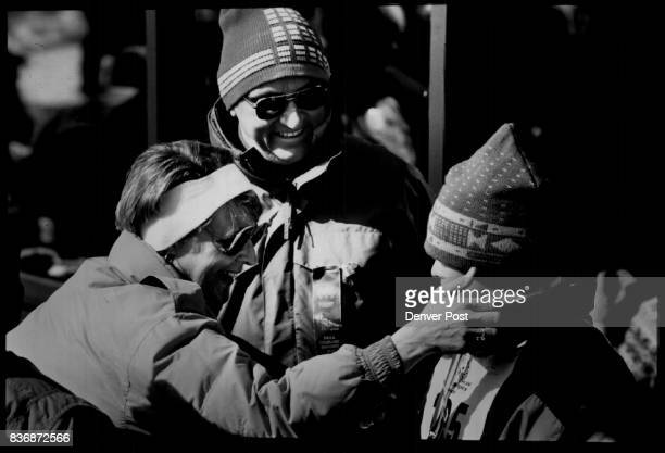 Olympic Special Jim and Sandy Hembd congratuate son Mike after he returned with his gold medal for the giant slalom his brother Mark got the silver...