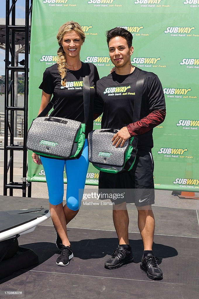 Olympic speed skater Apolo Ohno (R) and sports broadcaster Erin Andrews attend the Limited Edition SUBWAY Bag Unveling at Clinton Cove at Pier 96 on June 12, 2013 in New York City.