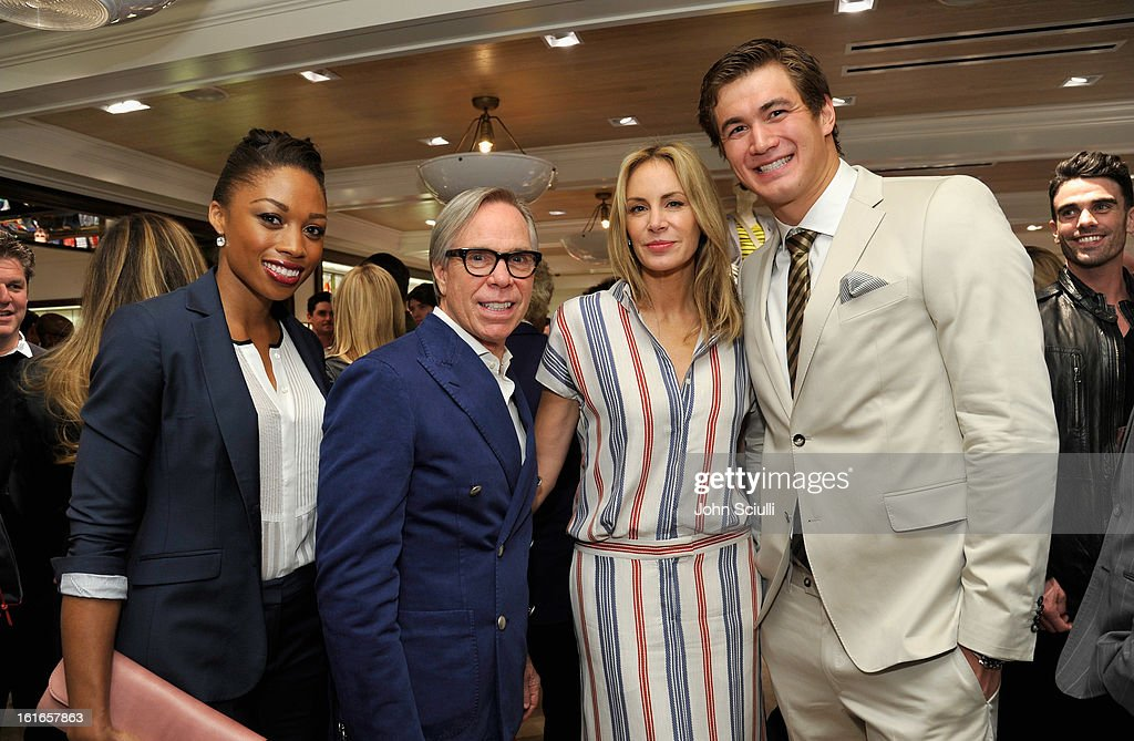 Olympic Sprinter Allyson Felix, fashion designer Tommy Hilfiger, Dee Hilfiger and Olympic Swimmer Nathan Adrian attend Tommy Hilfiger New West Coast Flagship Opening on Robertson Boulevard on February 13, 2013 in West Hollywood, California.