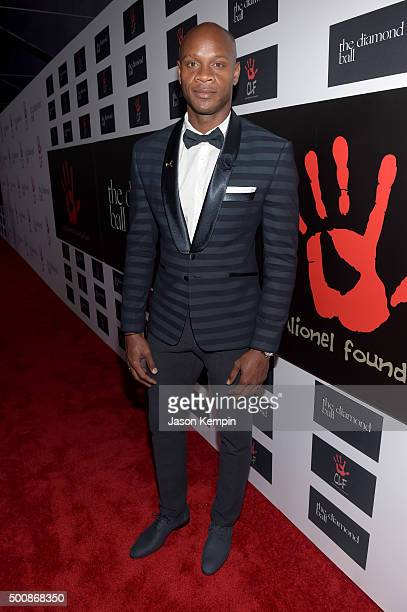 Olympic sprinter Asafa Powell attends the 2nd Annual Diamond Ball hosted by Rihanna and The Clara Lionel Foundation at The Barker Hanger on December...