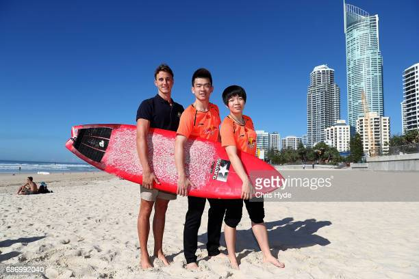 Olympic swimmer Cameron McEvoy and Badminton players Zheng Siwei and Chen Qingchen of China pose during a Sudirman Cup media opportunity at Surfers...