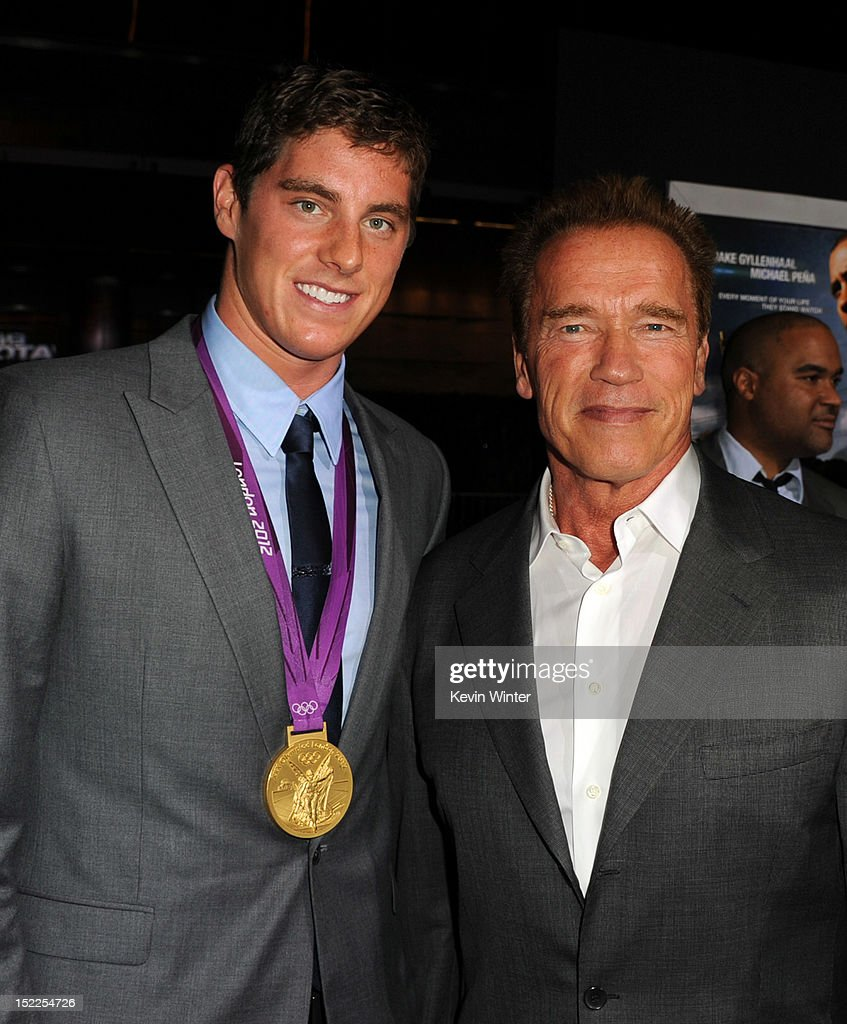 Olympic swimmer <a gi-track='captionPersonalityLinkClicked' href=/galleries/search?phrase=Conor+Dwyer&family=editorial&specificpeople=7988001 ng-click='$event.stopPropagation()'>Conor Dwyer</a> and <a gi-track='captionPersonalityLinkClicked' href=/galleries/search?phrase=Arnold+Schwarzenegger&family=editorial&specificpeople=156406 ng-click='$event.stopPropagation()'>Arnold Schwarzenegger</a> arrive at the premiere of Open Road Films' 'End of Watch' at Regal Cinemas L.A. Live on September 17, 2012 in Los Angeles, California.