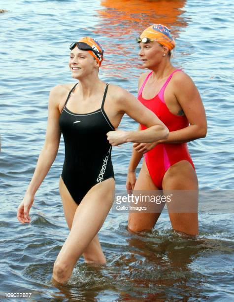 Olympic swimmer German Franziska van Almsick with Charlene Wittstock during the Midmar Mile from the Midmar Dam on February 12 2011 in...